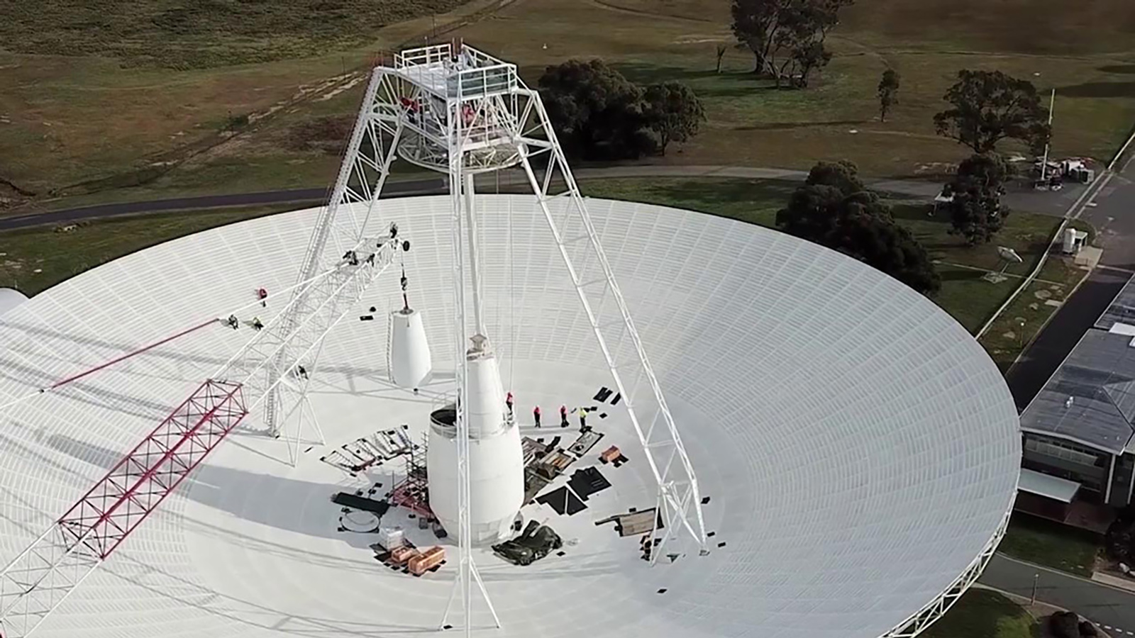 slide 1 - Workers fixing antenna in Canberra