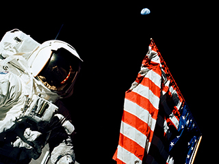 Astronaut and American Flag on the Moon