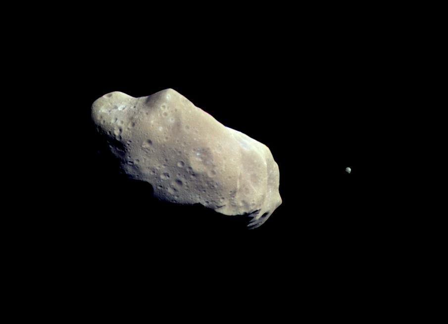 Color picture shows asteroid Ida and its moon, Dactyl.