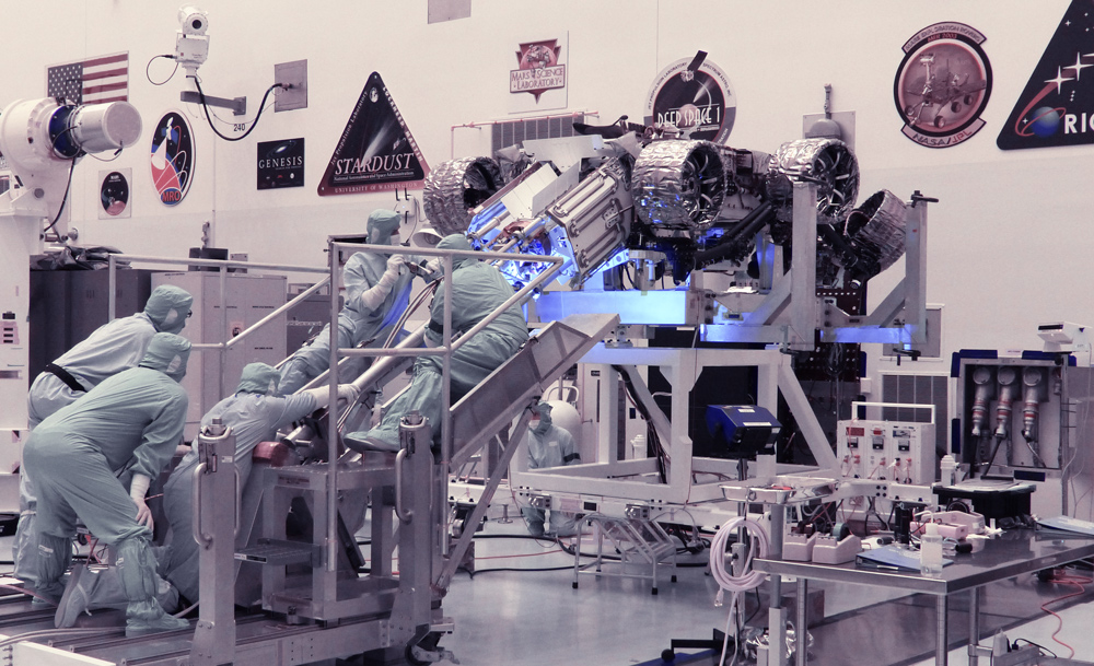 Technicians perform a fit check between the Mars Perseverance rover and its Multi-Mission Radioisotope Thermoelectric Generator
